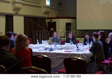 ST. PETERSBURG, RUSSIA - DECEMBER 16, 2015: Film director Alexey Uchitel (center) in the film studio Lendoc during the round table discussion of 4th St. Petersburg International Cultural Forum