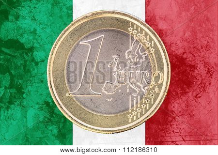 One Euro Coin On The Flag Of Italy As Background