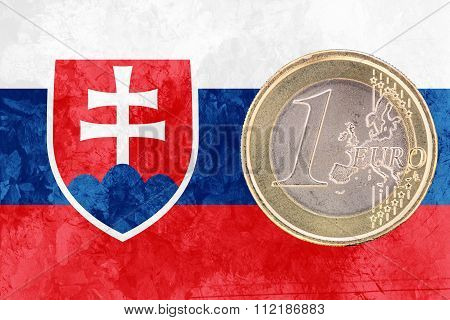 One Euro Coin On The Flag Of Slovakia As Background