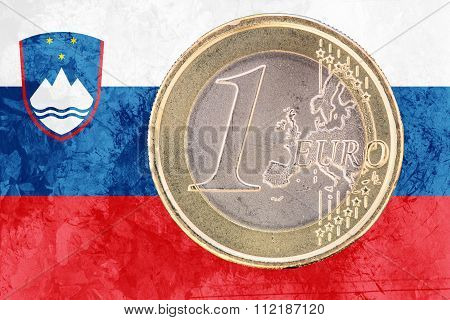 One Euro Coin On The Flag Of Slovenia As Background