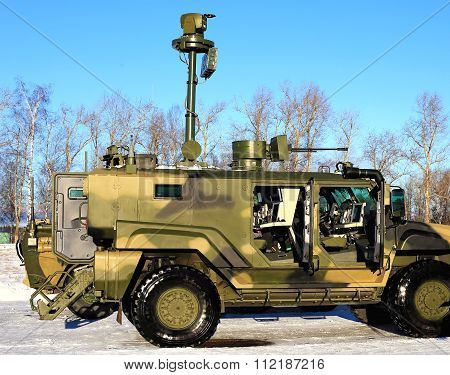 MOSCOW REGION - DECEMBER 17: Armoured tactical wheeled vehicle with the means of observation and fire strikes on December 17, 2015 in Moscow Region