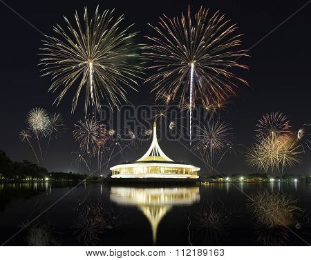 A Lighting Buiding With Beautiful Fireworks For Celebration At Twilight Time In Bangkok, Thailand