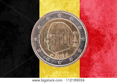 Belgian Two Euros Coin With Flag Of Belgium As Background
