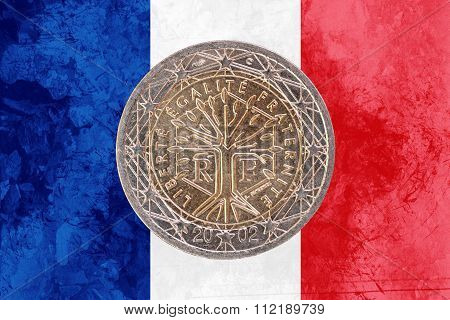 French Two Euros Coin With Flag Of France As Background