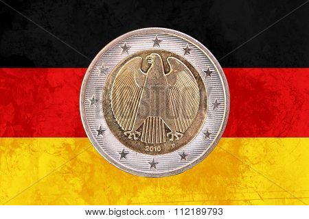 German Two Euros Coin With Flag Of Germany As Background