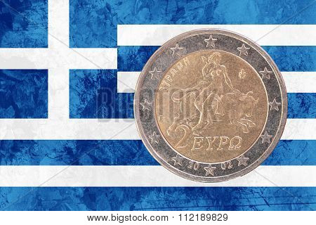 Greek Two Euros Coin With Flag Of Greece As Background