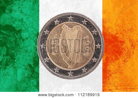 Irish Two Euros Coin With Flag Of Ireland As Background