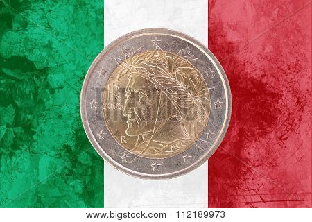 Italian Two Euros Coin With Flag Of Italy As Background