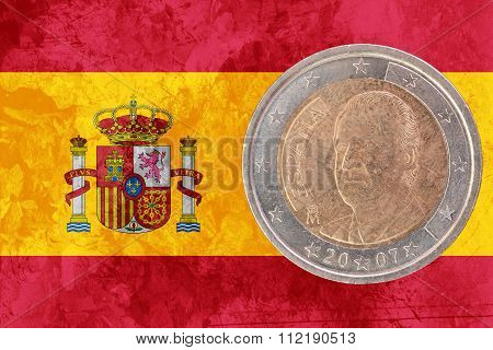 Spanish Two Euros Coin With Flag Of Spain As Background