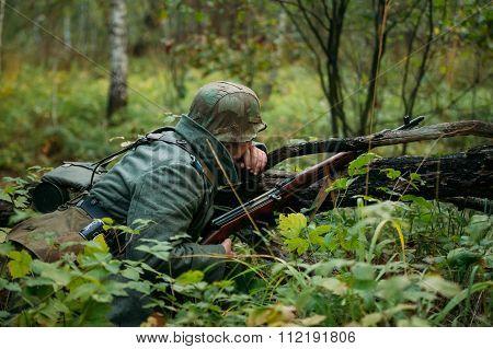 Hidden unidentified re-enactor dressed as german wehrmacht soldier