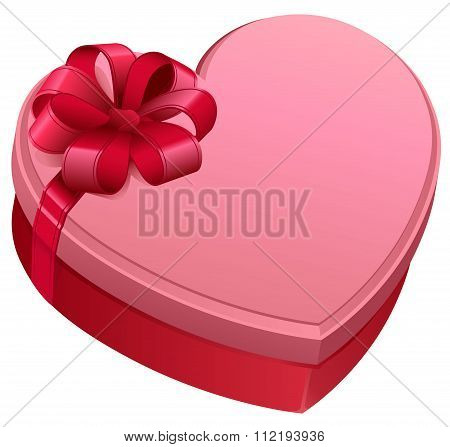 Pink gift box in heart shape. Gift box tied with bow