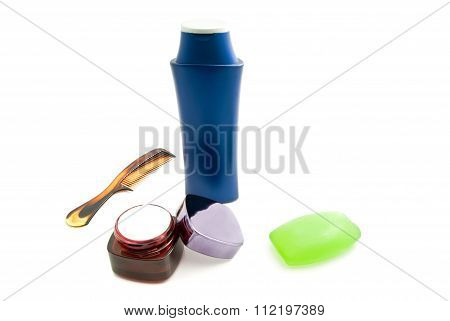 Comb And Other Toiletries On White