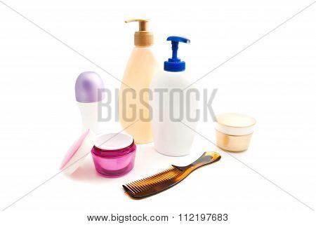 Deodorant, Gel, Cream And Hairbrush On White