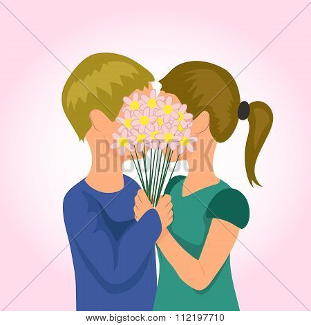 Valentine's Day. Young couple hugging and kissing behind a bouquet of flowers