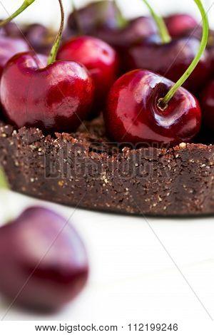 Homemade Raw Vegan Cherry Tart With Cherry On The Foreground