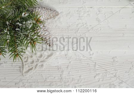 Christmas card with snow fir tree and pinecones
