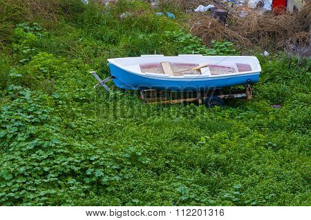 old boat abandoned on the field