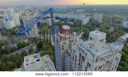 MOSCOW - SEP 15, 2015: Crane above building site of residential complex Falcon Fort at autumn evening. Aerial view videoframe
