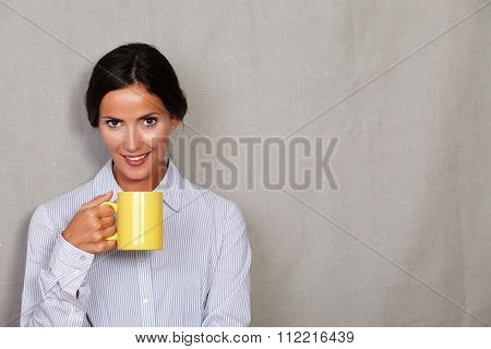 One Young Woman Holding Hot Drink