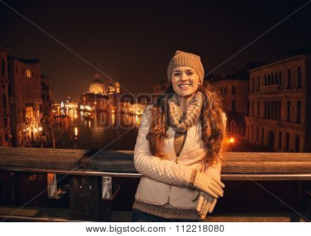 Happy Young Woman Standing On A Bridge Overlooking Grand Canal
