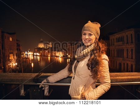 Smiling Young Woman Standing On