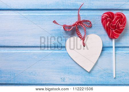 Lollipop Heart And Decorative Heart On Blue Painted  Wooden  Planks.