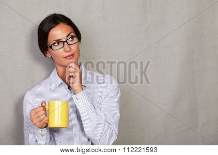 Wondering Businesswoman With Hand On Chin