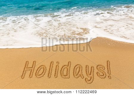 Holidays Written In Sand With Sea Surf