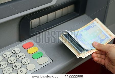 Withdrawal Of Money In European Banknotes From Automatic Cash Machine