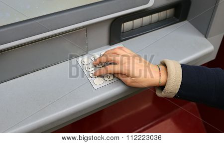 Hand And Numeric Keypad Of The Atm To Withdraw Money