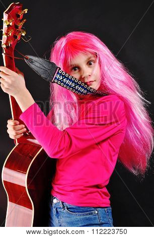 Teen Girl With Pink Hair Playing Guitar