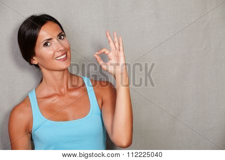 Excited Adult Woman Showing Ok Sign
