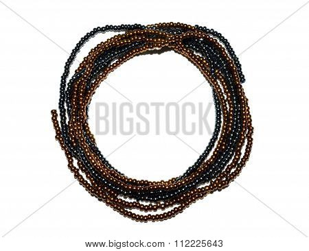 Circle of threads with black and golden beads on white background, you can write your text inside