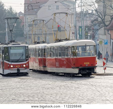 Two Red And White Tram, On Old One Modern