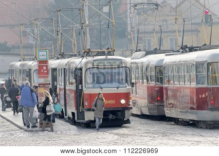 Two Red And White Vintage Tram In The Rush Hour