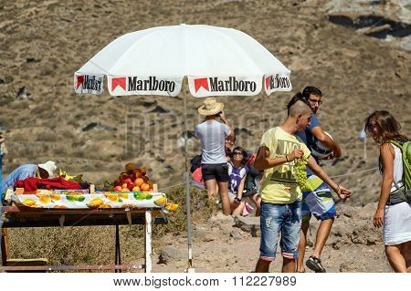 Street seller is offering fresh fruits to tourists