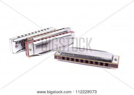 Harmonicas,  French Harps Or Mouth Organs Isolated On White Background