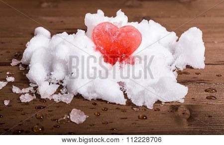Close Up Of Heart From Red Ice On Snow