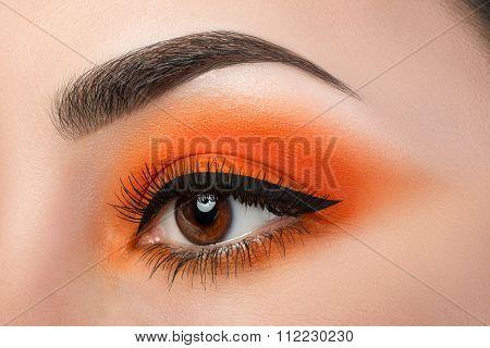 Close-up Of Woman Eye With Beautiful Orange Smokey Eyes