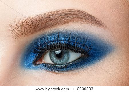 Close-up Of Woman Blue Eye With Beautiful Blue Smokey Eyes Makeup