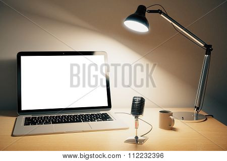 Blank White Laptop Screen With Lamp, Vintage Microphone On Wooden Table, Mock Up