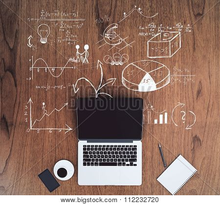 Blank Black Laptop Screen With Smartphone On Wooden Floor With Business Scheme Concept, Mock Up