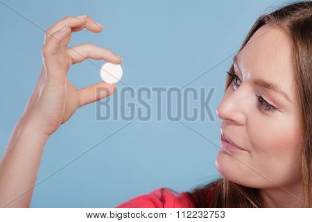 Woman With Painkiller Pill Tablet. Health Care.