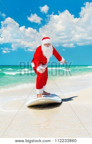 Santa Claus Windsurfer Go Surfing With Surfboard At Ocean Waves