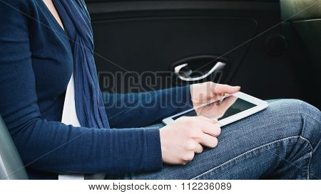 Car Trip - Woman With A Tablet