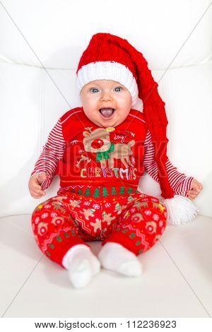 Baby girl posing in santa costume for Christmas