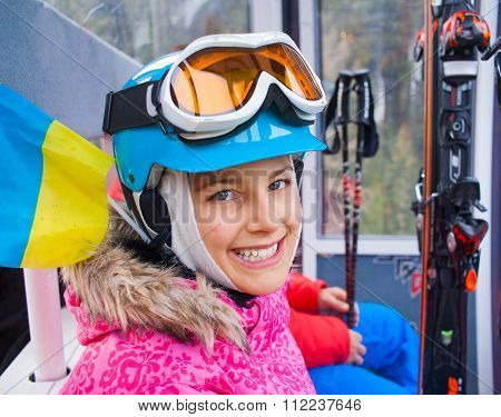 Little skier on ski lift