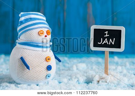 Signpost of the 1 January and two Snowman with red sled, gift stand near direction sign. Happy new y