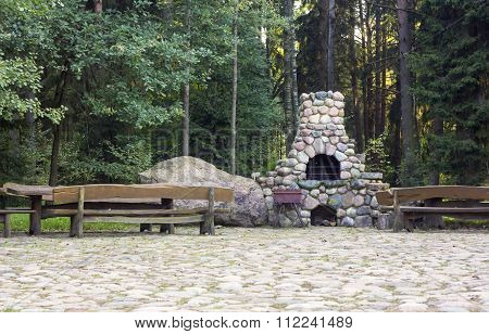 Stone Fireplace In A Rural Homestead