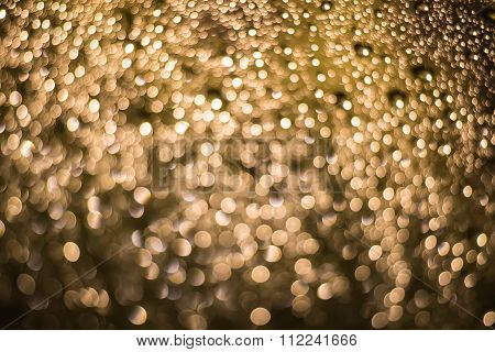 Abstract Blurred Dark Brown Light From Water Drop At The Windscreen Bokeh Background